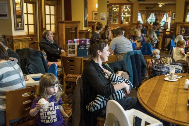 Mothers at a sling meet held in a pub.